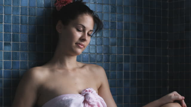woman sitting in a steam room