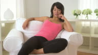 woman sitting in sofa chair in living room