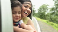 Woman sitting with her daughter in a car, Malshej Ghat, Maharashtra, India
