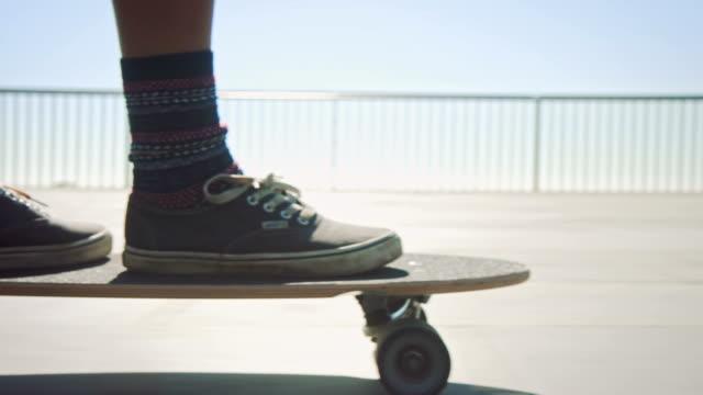 Woman skateboarding at beach