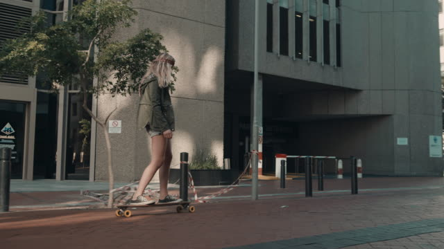 Woman skating in urban setting