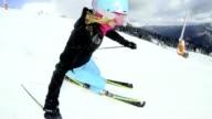 SLO MO POV Woman skiing down ski slope