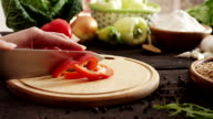 Woman slicing pepper