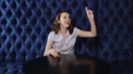 Woman Smiling and Waving in Bar