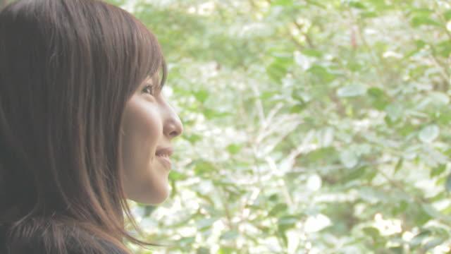 Woman smiling in garden
