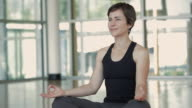 MS DS Woman smiling in yoga studio / Vancouver, British Columbia, Canada