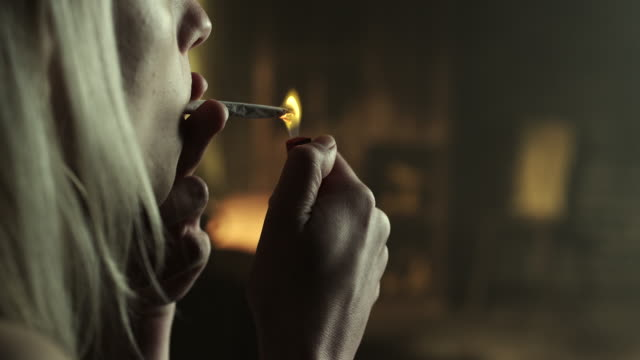 Woman smoking marijuana joint