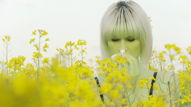 HD: Woman Sneezing From Pollen Allergy