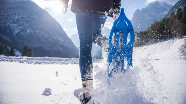 Woman snowshoeing on fresh snow
