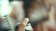 Woman spraing hairs - Stock Footage