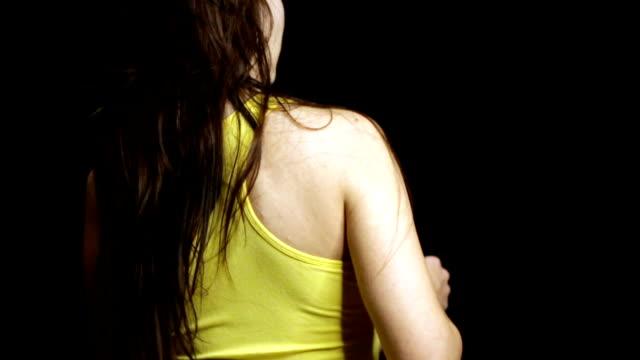 woman spraying deodorant