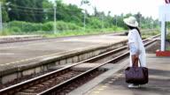 Woman stand platform waiting train