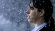 Woman Standing In The Heavy Rain