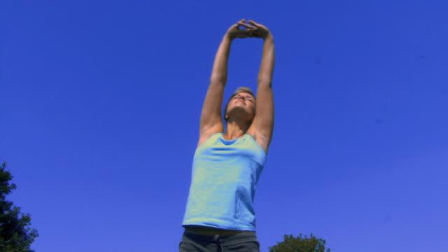 MS Woman stretching / Hampstead, United Kingdom