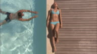 OH WS Woman sunbathing on edge of wooden deck over swimming pool/ Cape Town, South Africa