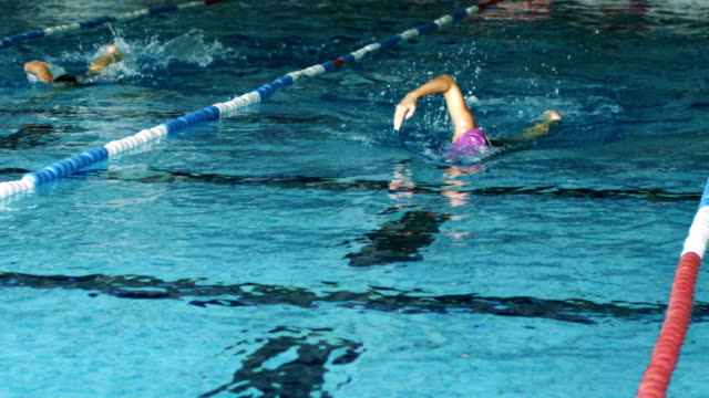 Woman swimmer swims crawl style