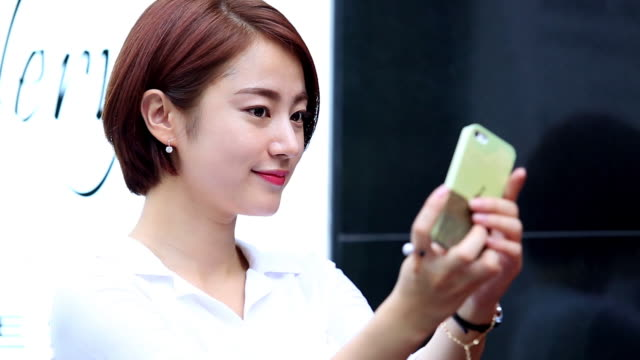 A woman take a picture by her self