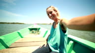 Woman takes selfie on a boat