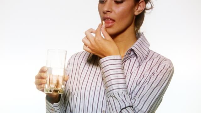 HD: Woman Taking a Pill