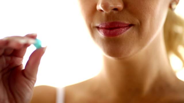 Woman taking a pill.