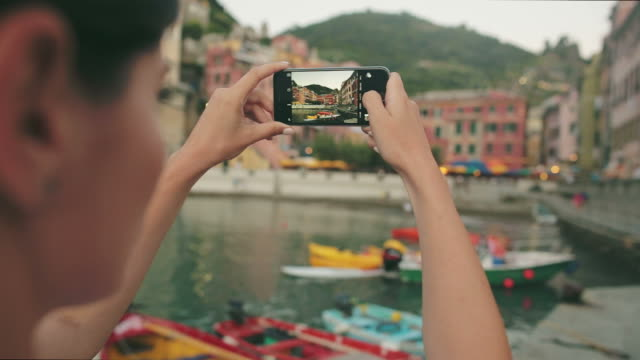 Woman taking pictures in Vernazza - Cinque Terre village.