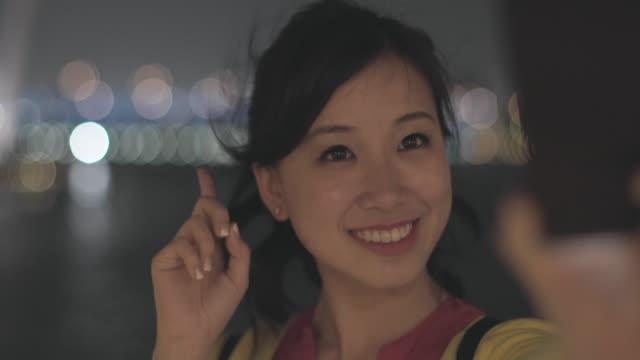 CU Woman taking selfie at night