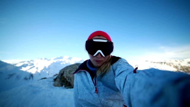 Woman taking selfie from ski slopes