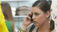 HD: Woman Talking On Phone And Shopping