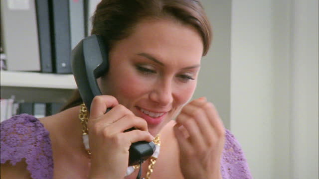 CU Woman talking on phone in office, New York City, New York, USA