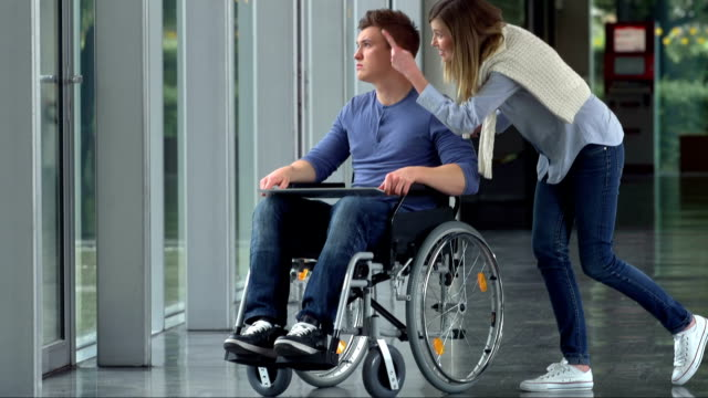 LS TU Woman Talking With Her Friend In Wheelchair