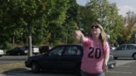 Woman throwing around a football
