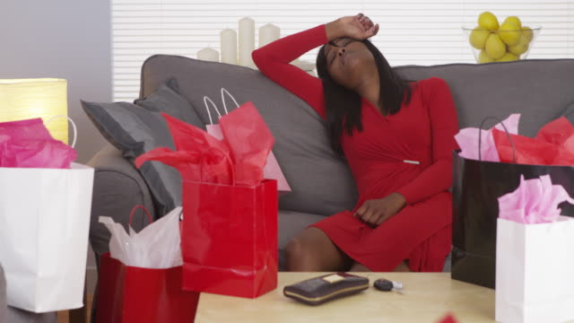 woman tired after shopping for hours