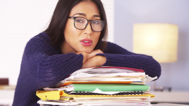 woman tired of doing paperwork