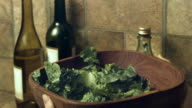 CU, SLO MO, woman tossing salad in bowl