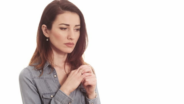 woman touching ring thinking about marriage problems