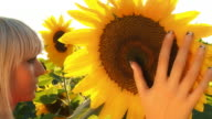 HD DOLLY: Woman Touching The Sunflower