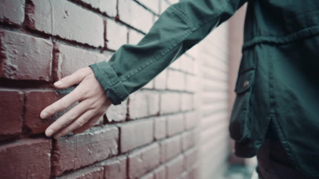 Woman touching wall