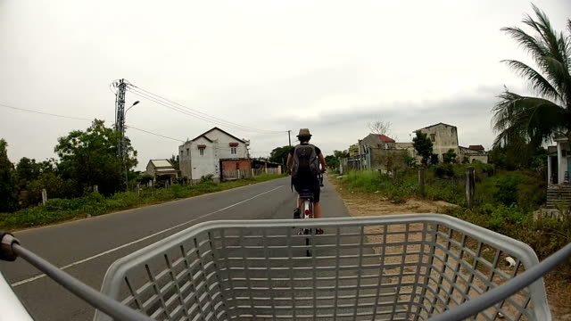 POV Woman Tourist Cycling in Hoi An, Vietnam