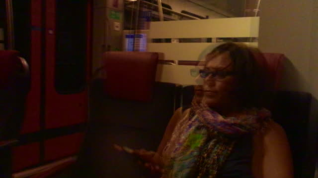 Woman Travel in a Train and Reflected in the Window and Using Smartphone