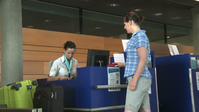 MS Woman traveller at check in counter / Luxembourg Airport, Findel, Luxembourg, Luxembourg
