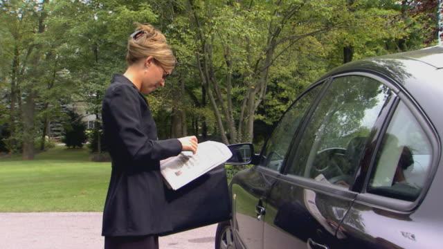 Woman trying to unlock car door