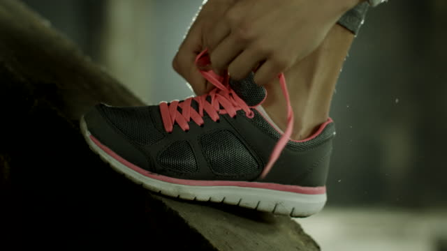 Woman tying her exercise shoes