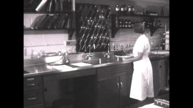 Woman typing in office / woman at work in lab pours liquid on microscope slides/ men looking through microscopes obtaining samples from chickens