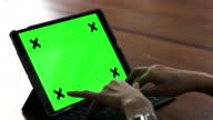 Woman typing keyboard of Digital tablet green screen