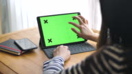 Woman typing keyboard of Digital tablet with Chroma key, Slow motion