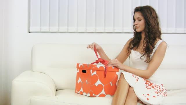HD: Woman Unwrapping Gift box