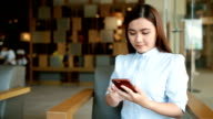 Woman use a smart phone in cafe