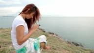 woman use mobile smartphone on mountain