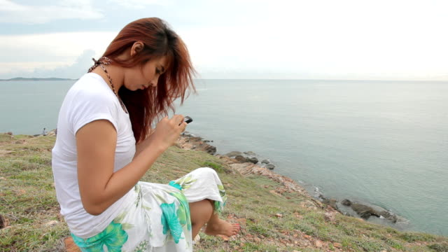 woman use mobile smartphone on mountain