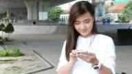 Woman use smart phone at park